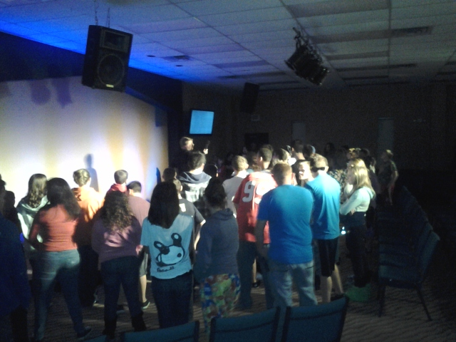 83 teens worshiping the Lord on a friday night